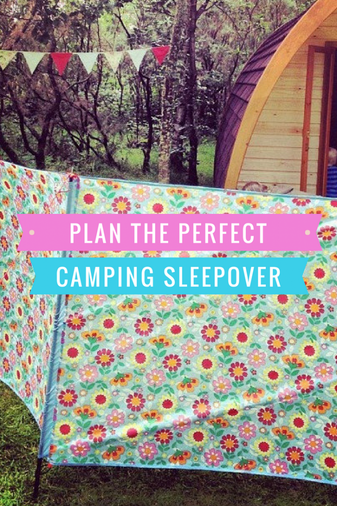 "wooden camping pod in the woods with cath kidston flowery windbreak and bunting. Text overlay saying ""plan the perfect camping sleepover"""
