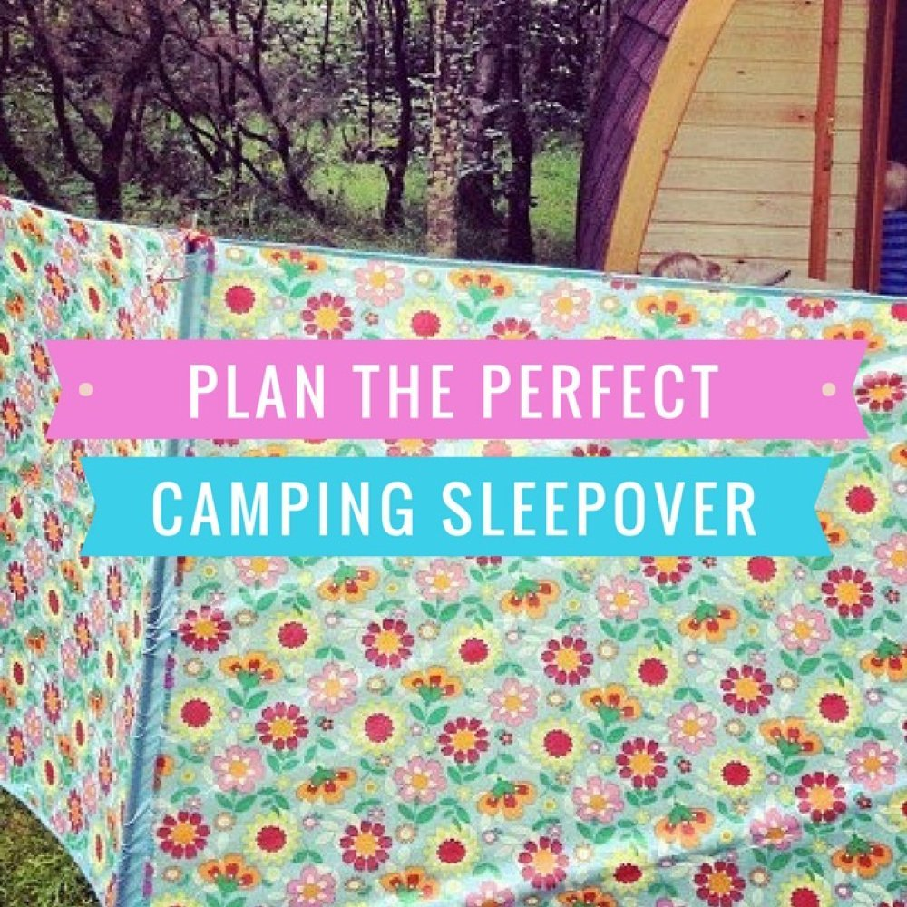 wooden camping pod in the woods with cath kidston flowery windbreak and bunting. Text overlay saying