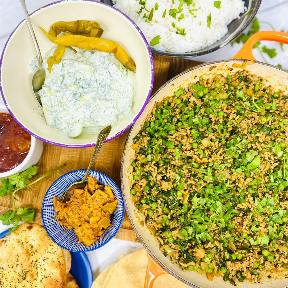 lamb keema served with boiled rice, mint raita, mini naan breads, lime pickle and popadoms