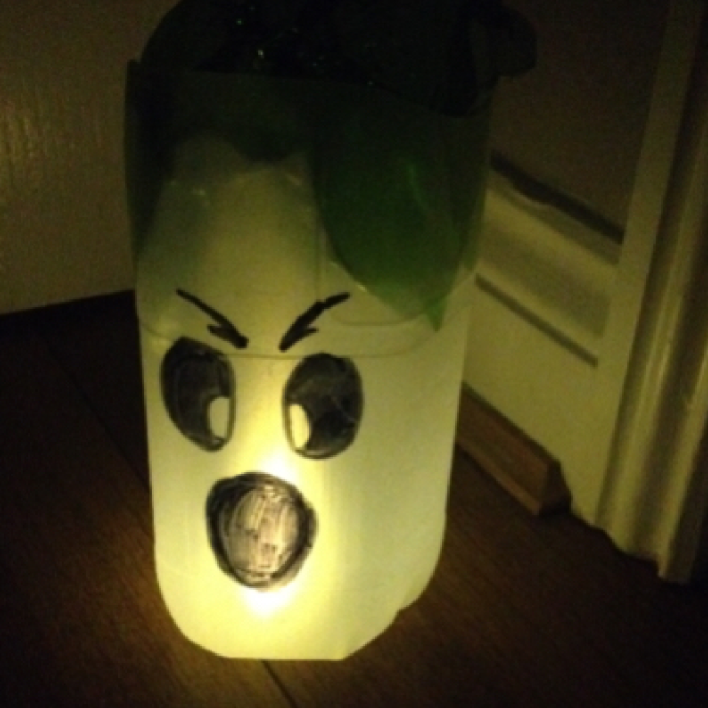 halloween ghost lantern made from a milk bottle