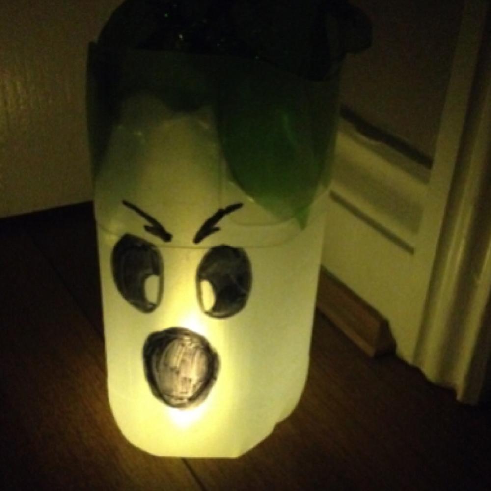 halloween ghost lantern made from a milk bottle
