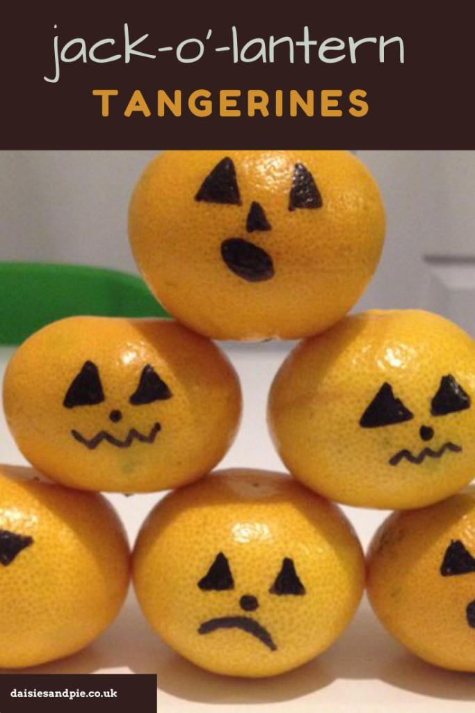 "pile of tangerines with jack o lantern faces drawn onto them. Text overlay ""jack o lantern tangerines"""