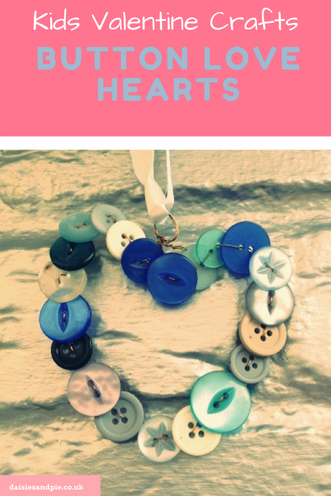 """homemade heart decoration made from different shades and types of blue buttons held on wire and hung with a blue ribbon against a silver painted brick wall. Text """"kids valentine's day crafts - button love hearts - www.daiseisandpie.co.uk"""""""