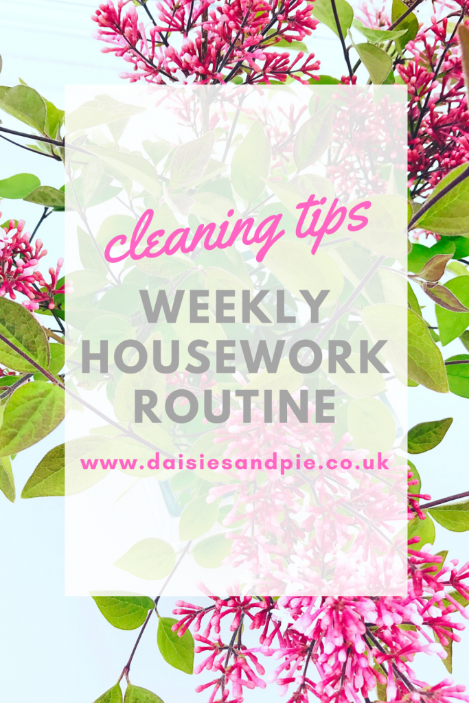 """vase of fresh lilacs. Text overlay """"cleaning tips - weekly housework routine - www.daisiesandpie.co.uk"""""""