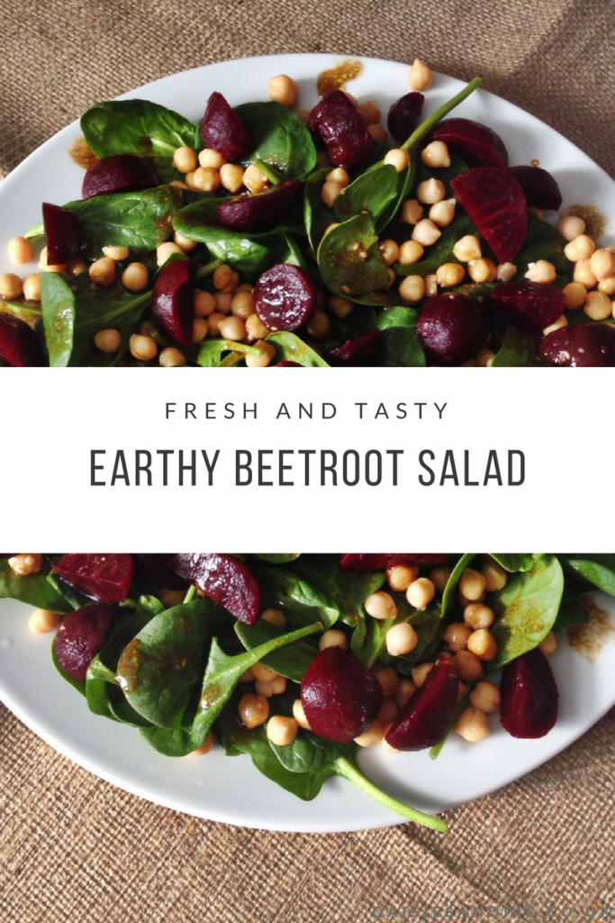 "hessian table cloth with white plate holding spinach, beetroot and chickpea salad with Balsamic salad dressing drizzled over the top. Text overlay saying ""fresh and tasty earthy beetroot salad"""