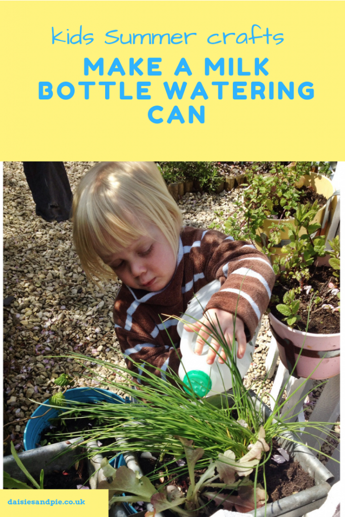 toddler watering garden with a homemade milk bottle watering can