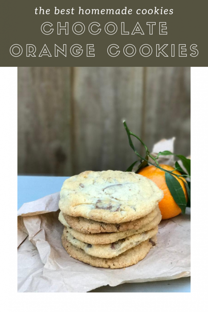 """stack of homemade chocolate orange cookies alongside an orange. Text overlay """"the best homemade cookies - chocolate orange cookies"""""""