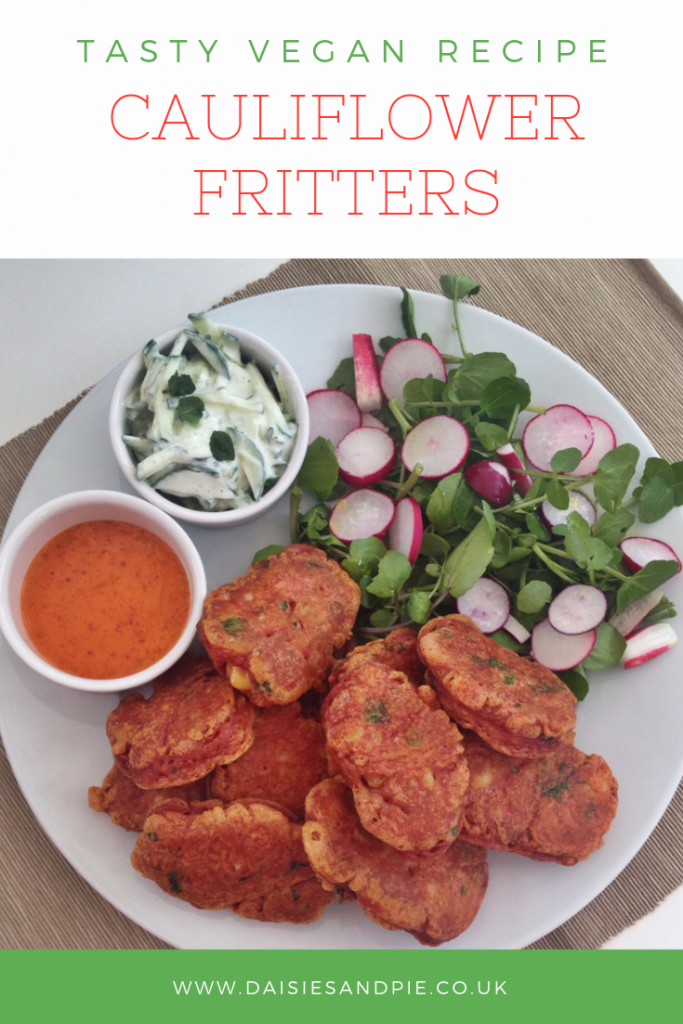 "platter of cauliflower fritters served with chilli dipping sauce, mint raita and radish salad. Text overlay saying ""tasty vegan recipe - cauliflower fritters"""
