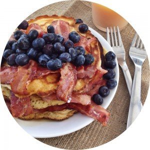 american style pancakes with bacon blueberries and maple syrup