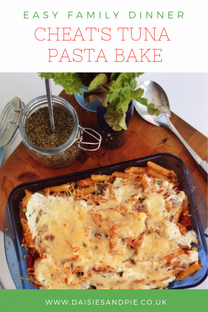 "casserole dish filled with tuna pasta bake alongside salad and serving spoons. Text overlay saying ""quick dinner recipe - cheat tuna pasta bake"""