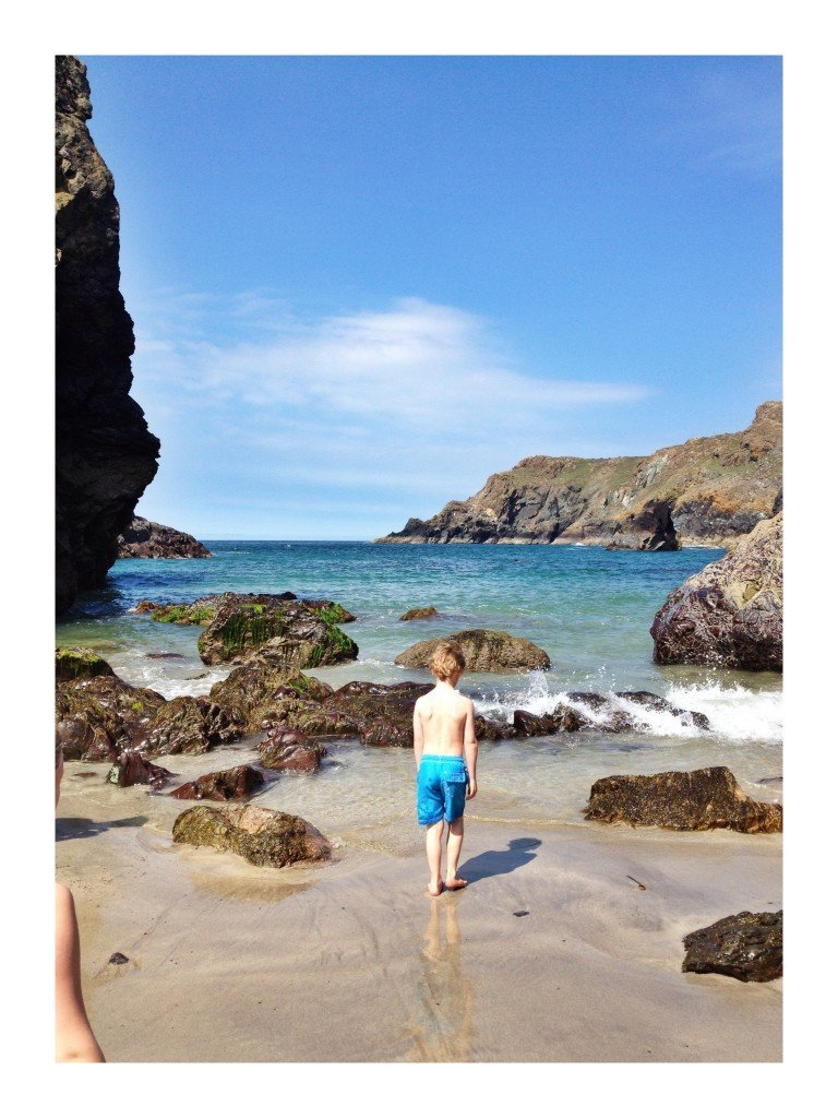 kids playing on the sand at Kynance Cove on the Lizard Peninsular in Cornwall