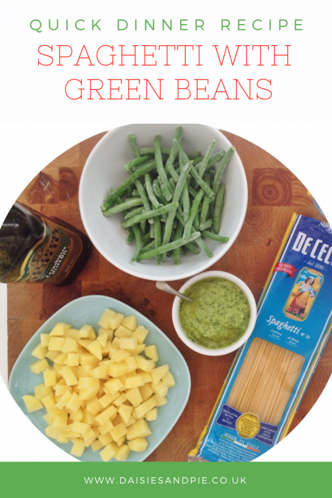 "wooden board with ingredients for green bean and pesto spaghetti. Text overlay saying ""quick dinner recipe spaghetti with green beans"""