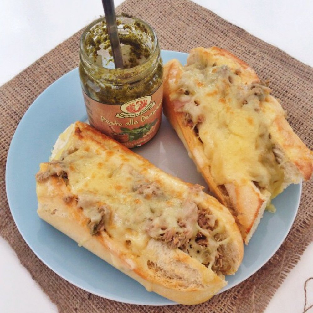 tuna melt baguette made with canned tuna, pesto and cheese