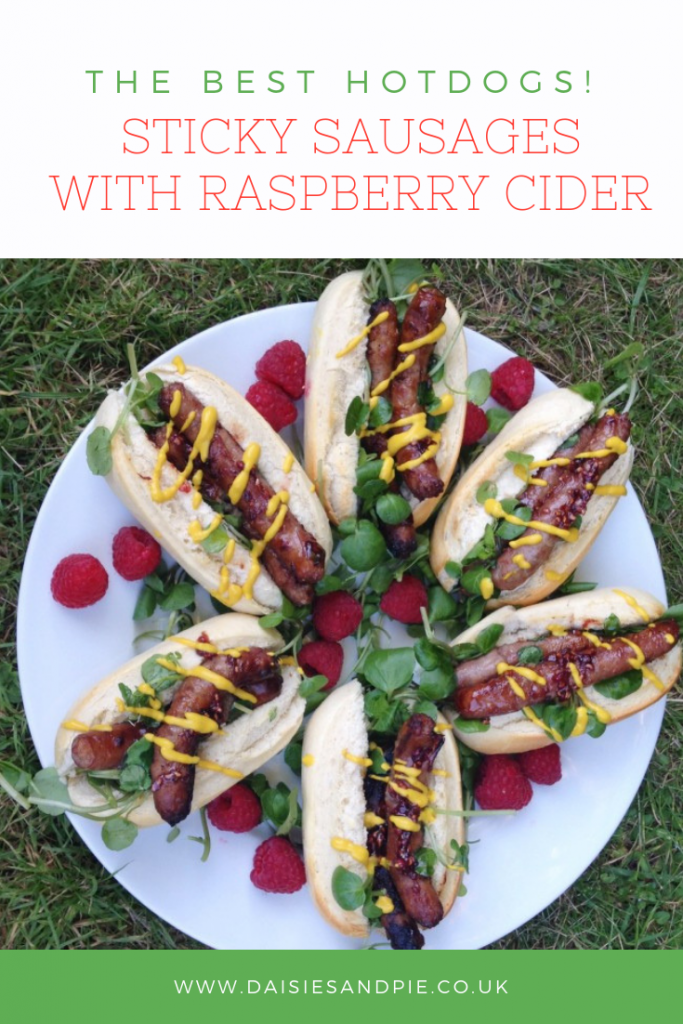 """sharing platter with homemade hotdogs made using sticky sausages that have been marinated in raspberry cider. Text overlay saying """"the best hotdogs - sticky sausages with raspberry cider"""""""