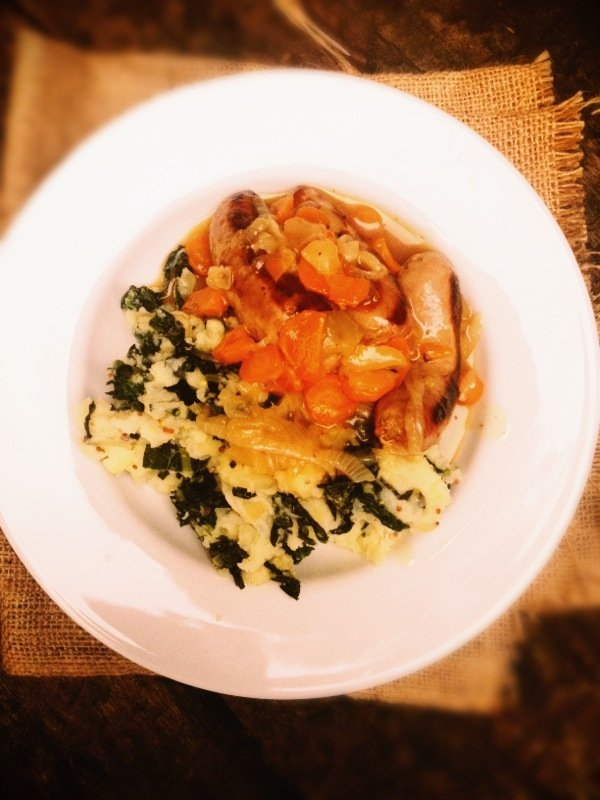 Sausage and cider casserole with colcannon