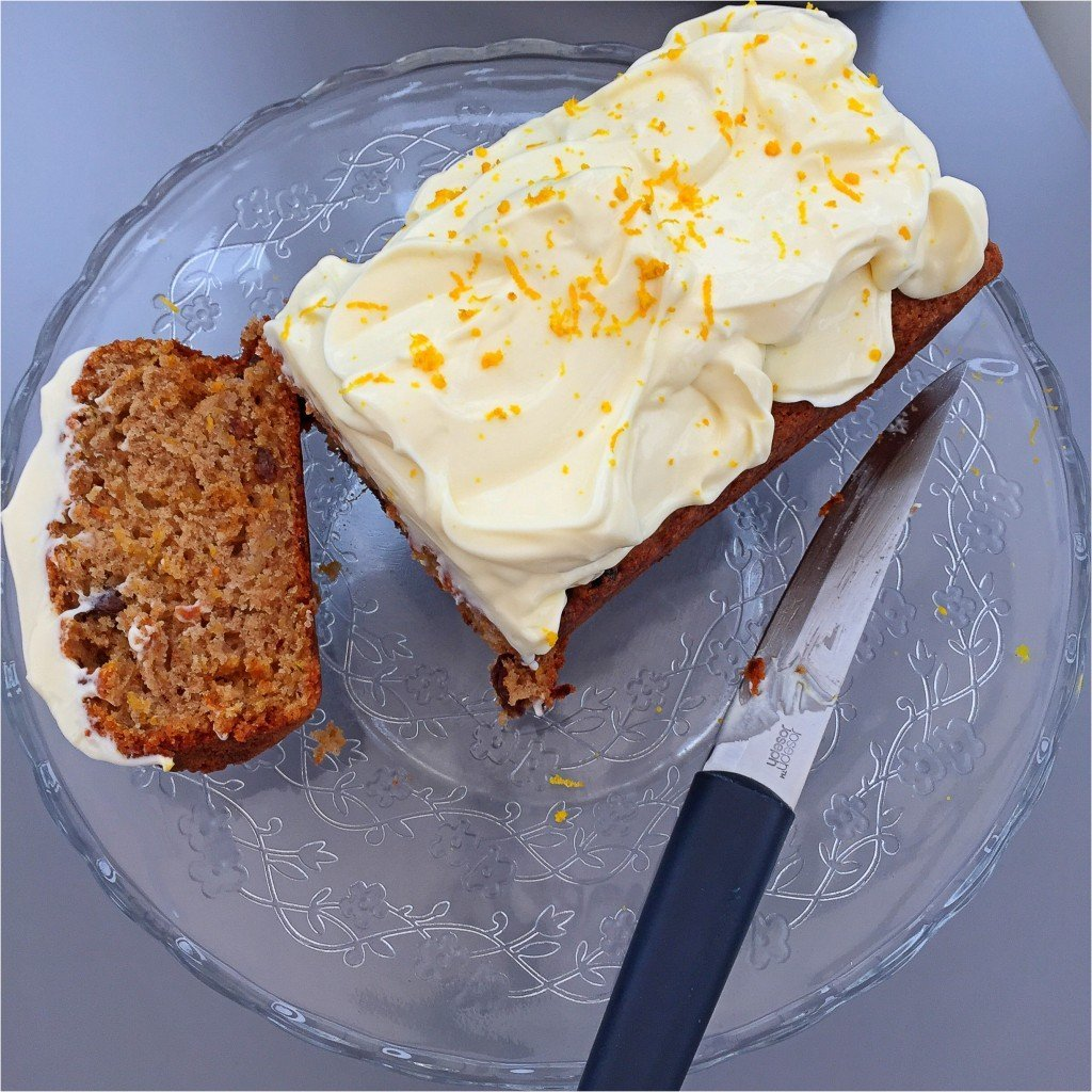squash cake with orange spiked cream cheese frosting on a cake stand