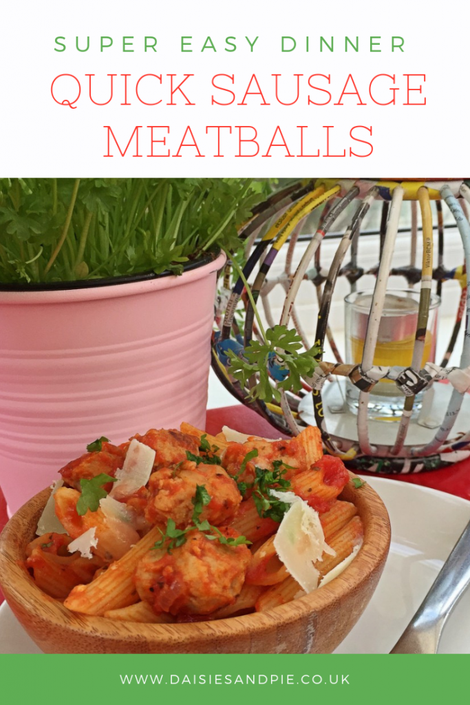 "wooden bowl filled with homemade sausage meatballs and pasta tossed in tomato sauce. Text overlay saying ""super easy dinner - quick sausage meatballs"""