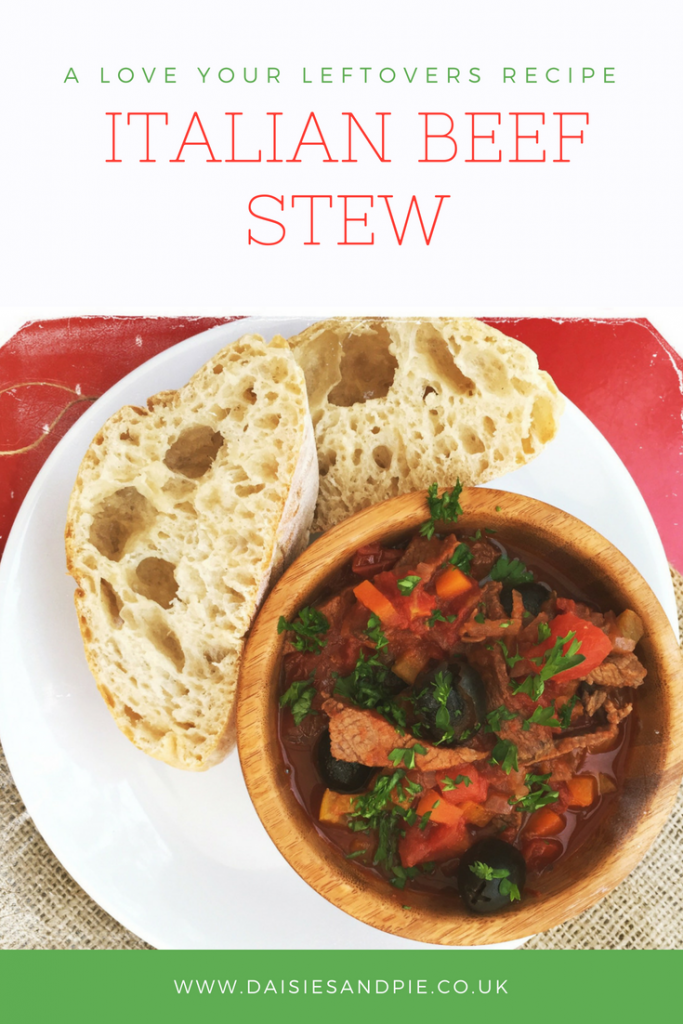 wooden bowl filled with homemade Italian beef stew with 2 slices of ciabatta on the side for mopping up the juices