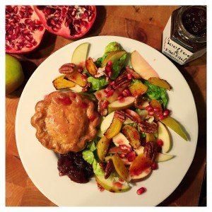 autumn salad with apple and beetroots served with chutney and a pork pie