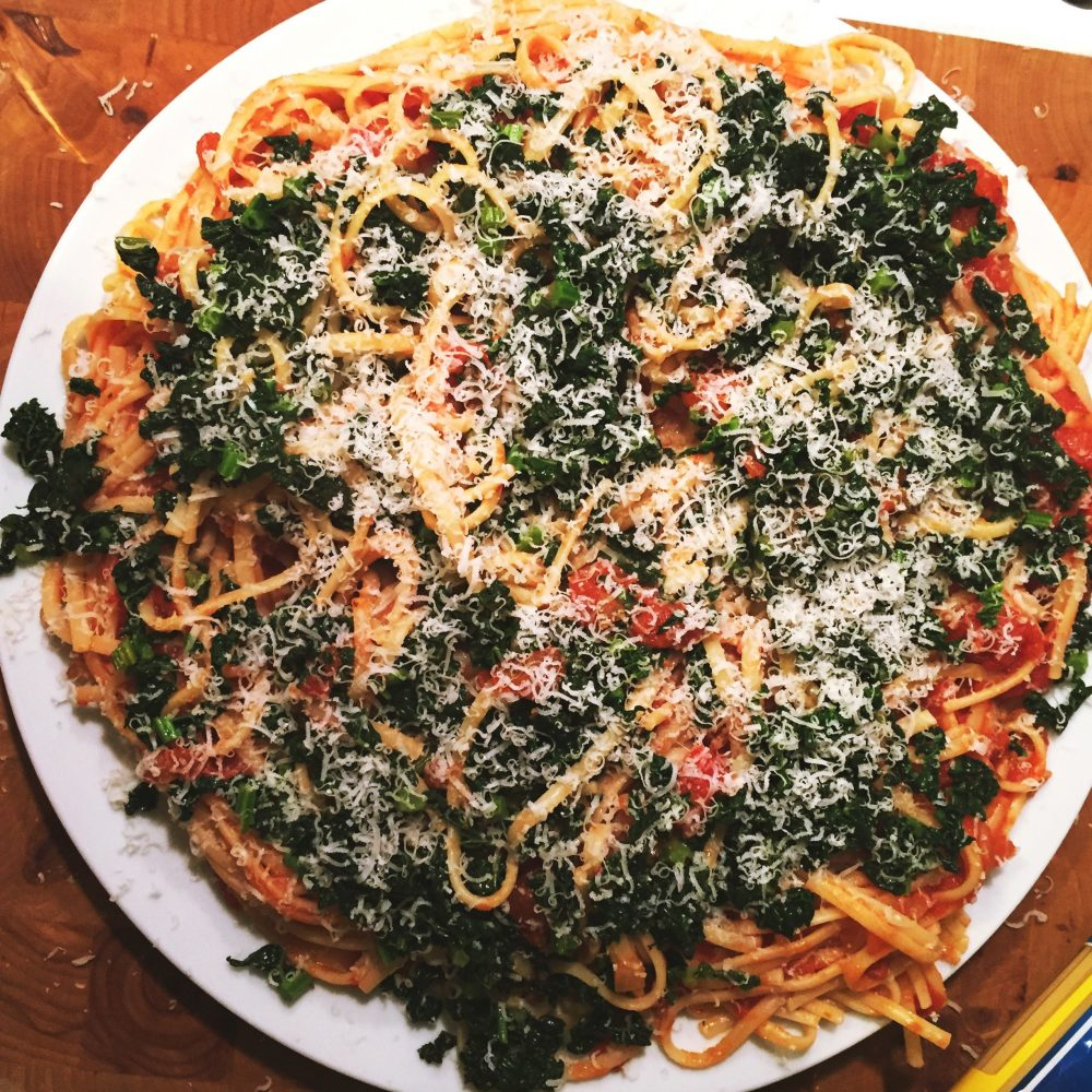 cavolo nero pasta with tomatoes scattered with Italian cheese