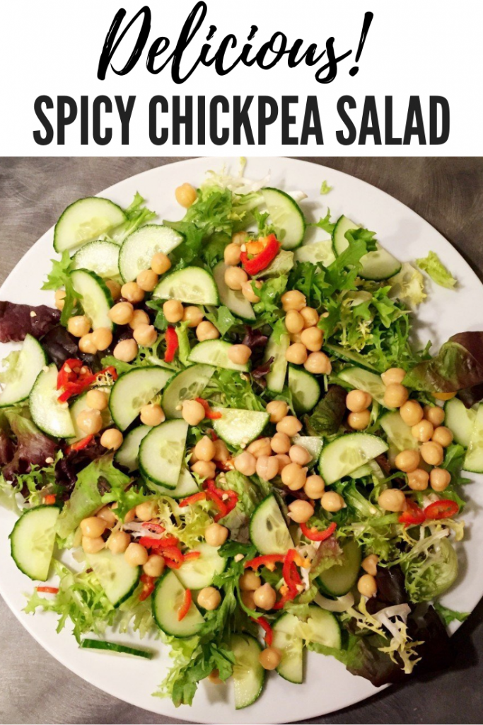 "spicy chickpea salad with chillies scattered over the top. Text overlay reads ""delicious spicy chickpea salad"""