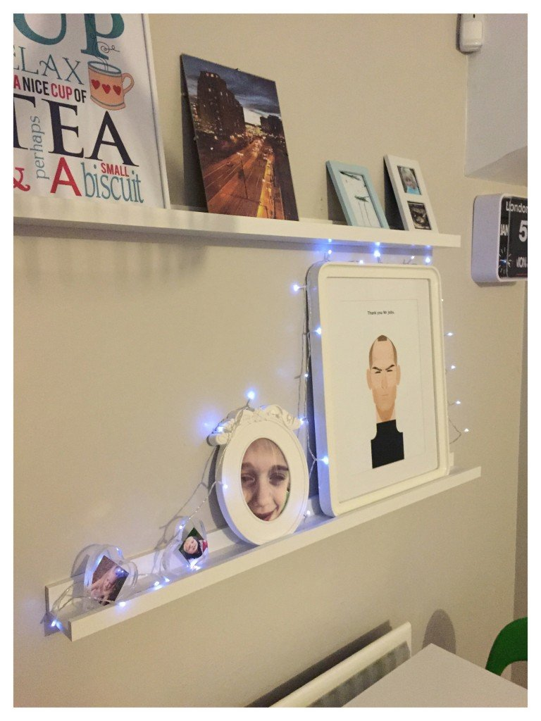 fairy lights draped around pictures, decorating with fairy lights, family home style, daisies and pie