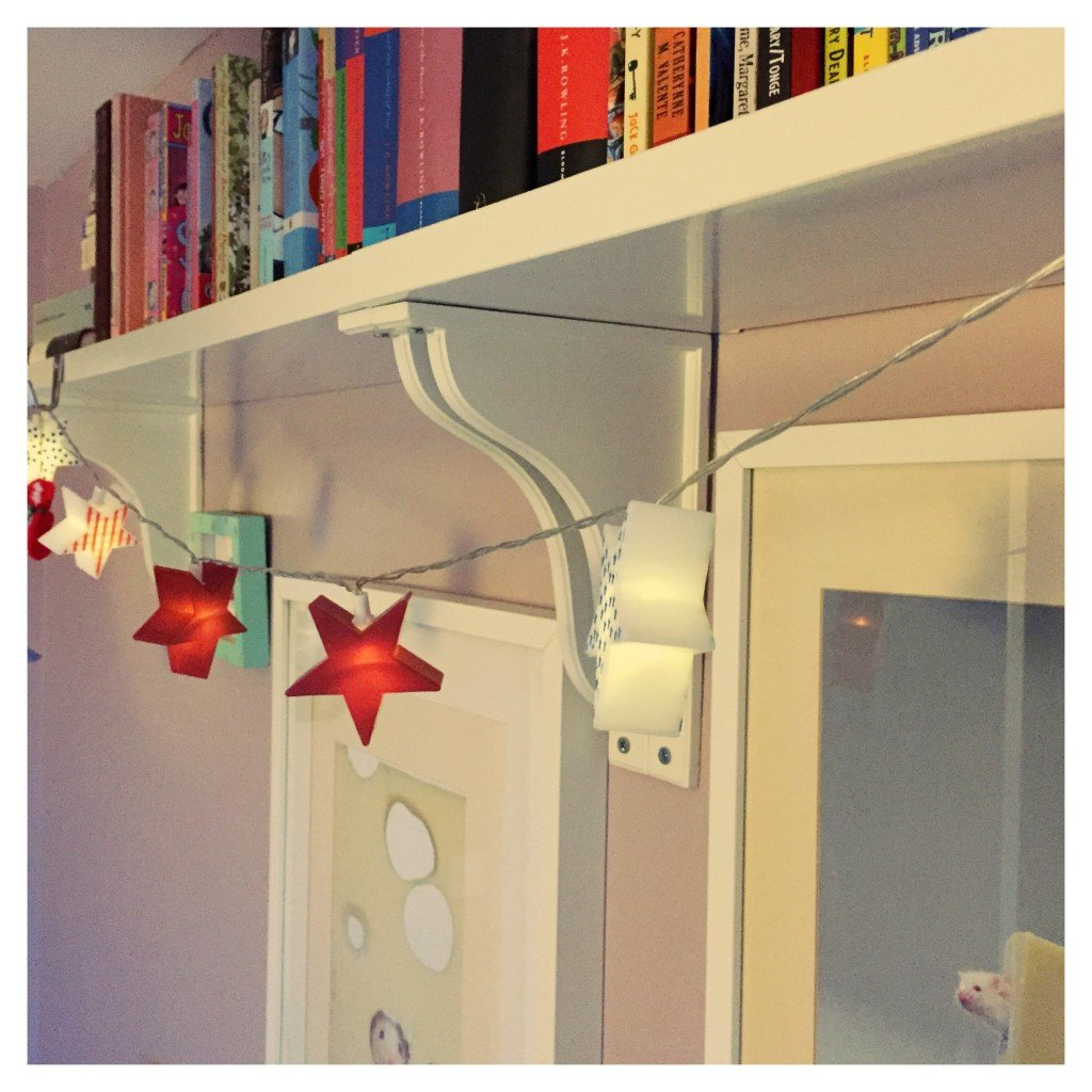 fairy lights on bookshelves, fairy lights in kids rooms, family home style, daisies and pie