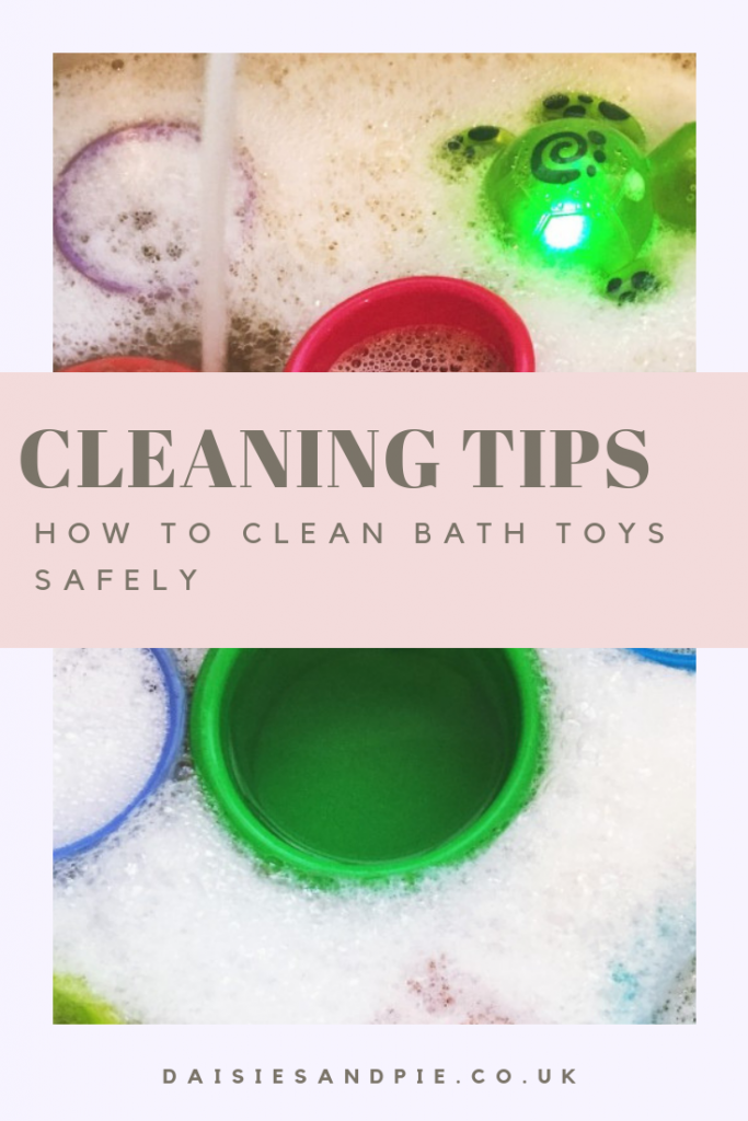 """sink of bubbly water with kids bath toys in it. Text """"cleaning tips - how to clean bath toys safely"""""""