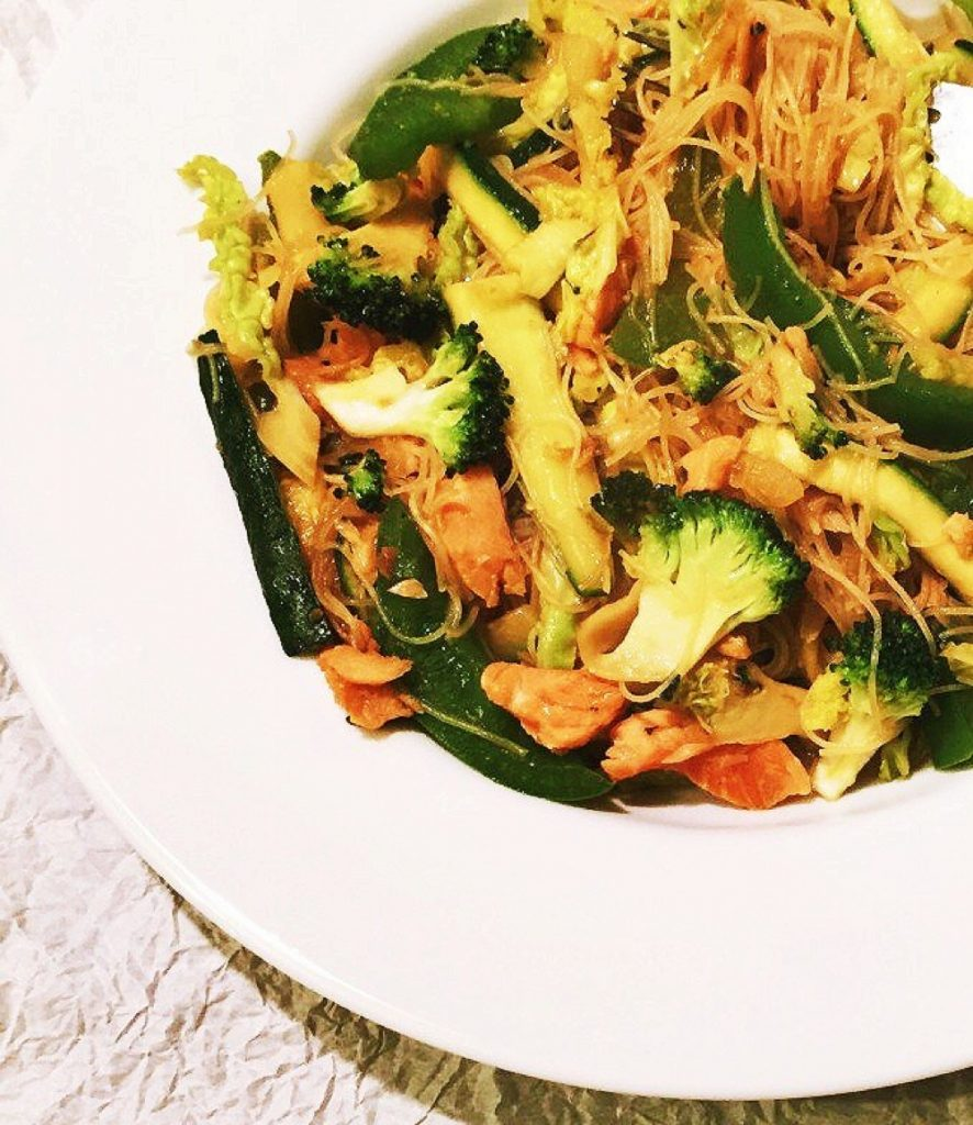 homemade smoked salmon and ginger stir fry with broccoli and noodles