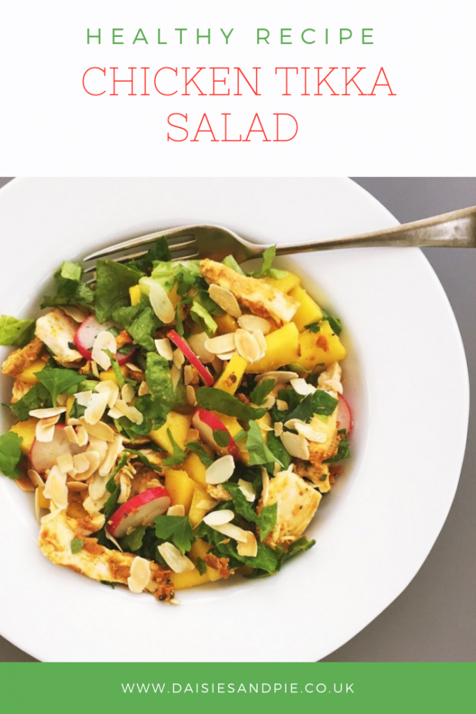 "chicken tikka salad with mango and radishes. text overlay saying ""healthy recipe - chicken tikka salad"""