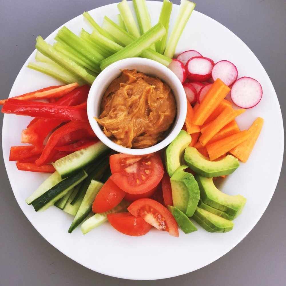 Crunchy salad platter with spicy peanut dip