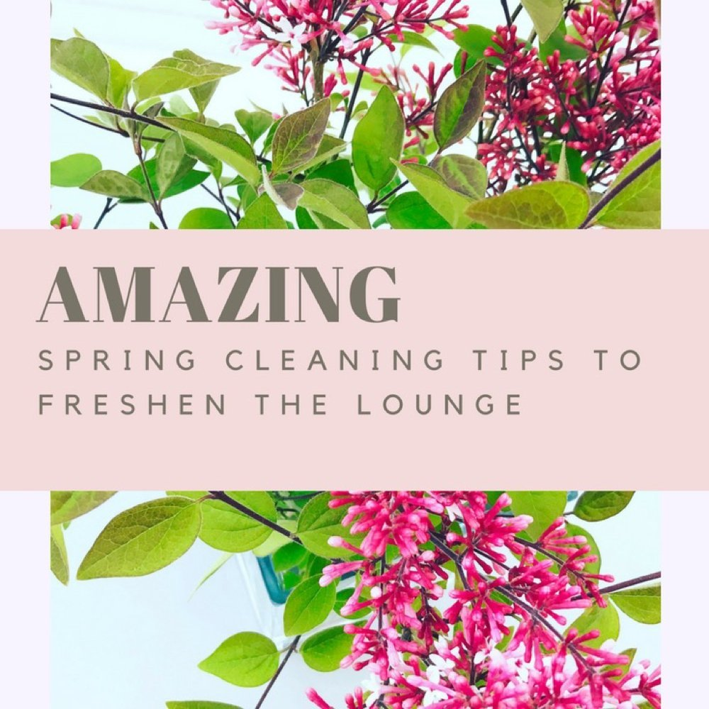 """Vase of beautiful bright pinky purple lilac flowers. Text overlay saying """"amazing spring cleaning tips to freshen the lounge"""""""