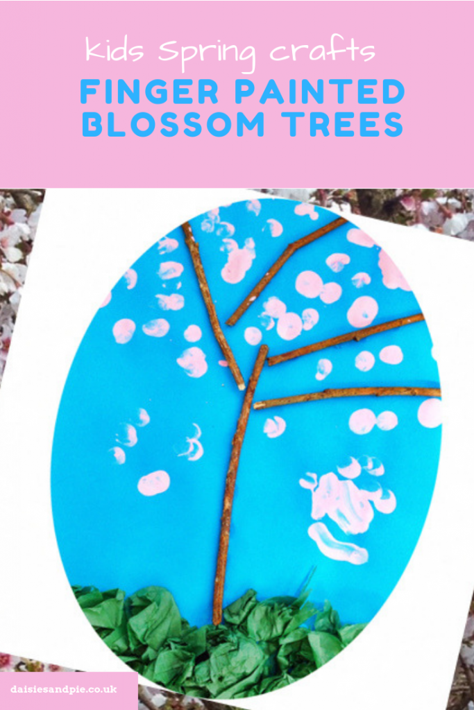 "kids spring craft - blossom tree made from twigs with finger painted blossom in pink. Text overlay saying "" kids spring crafts - finger painted blossom trees"""