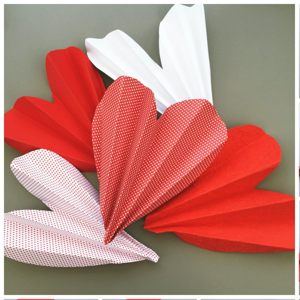 pink, red and white paper love heart fans