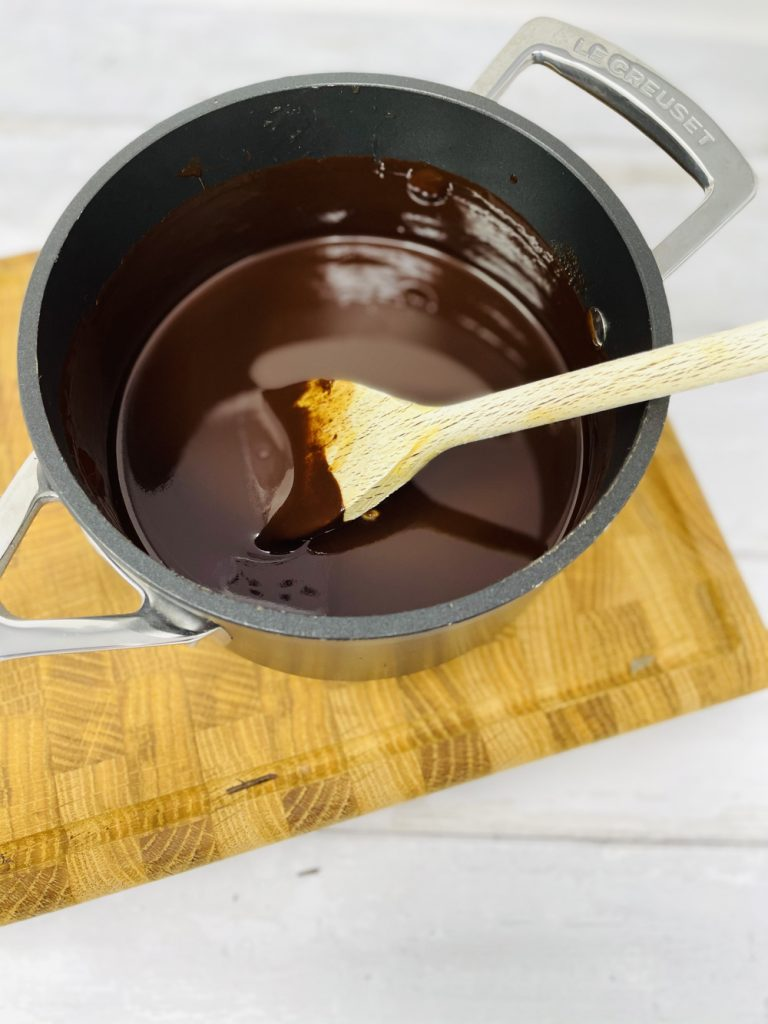 pan of melted chocolate, syrup and butter ready to make rocky roads