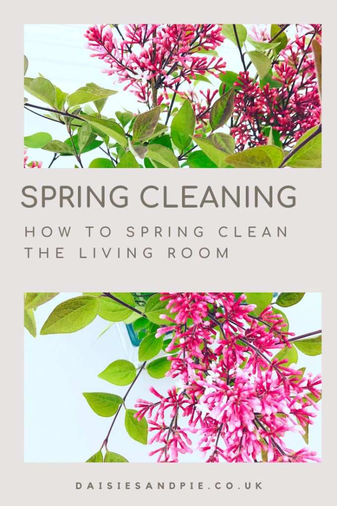 """vase of lilacs on a white table - Text """"spring cleaning - how to spring clean the living room"""""""