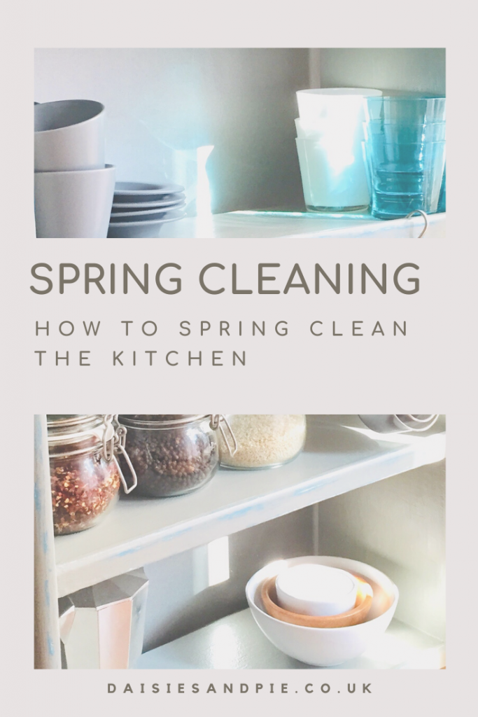 """pale grey painted wooden shelves with stacks of cups, saucers, glasses and jars of pulses. Text overlay """"spring cleaning - how to spring clean the kitchen"""""""