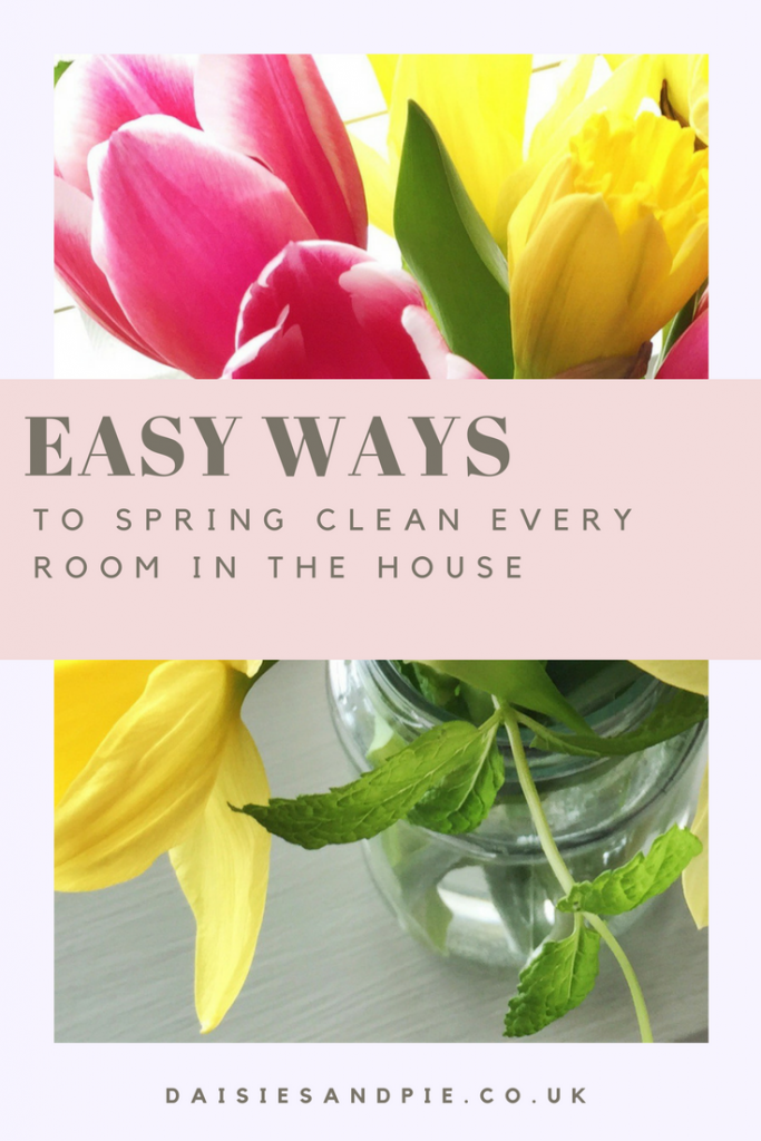"jam jar filled with pink tulips and yellow spring daffodils along with fresh mint. Text overlay saying ""easy ways to spring clean every room in the house"""