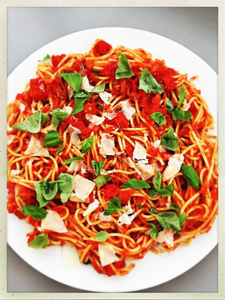 huge white platter filled with piles of homemade spaghetti alla marinara