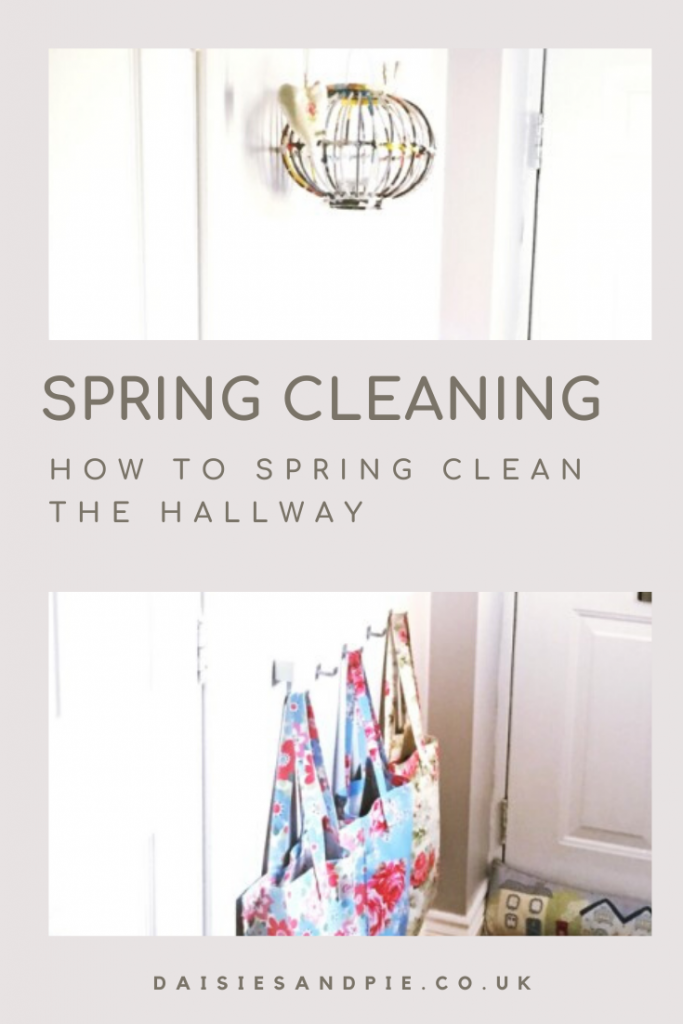 "bright, light hallway painted white with Cath Kidston tote bags hung on pegs and a lantern hung from a hook. Text ""spring cleaning - how to spring clean the hallway"""