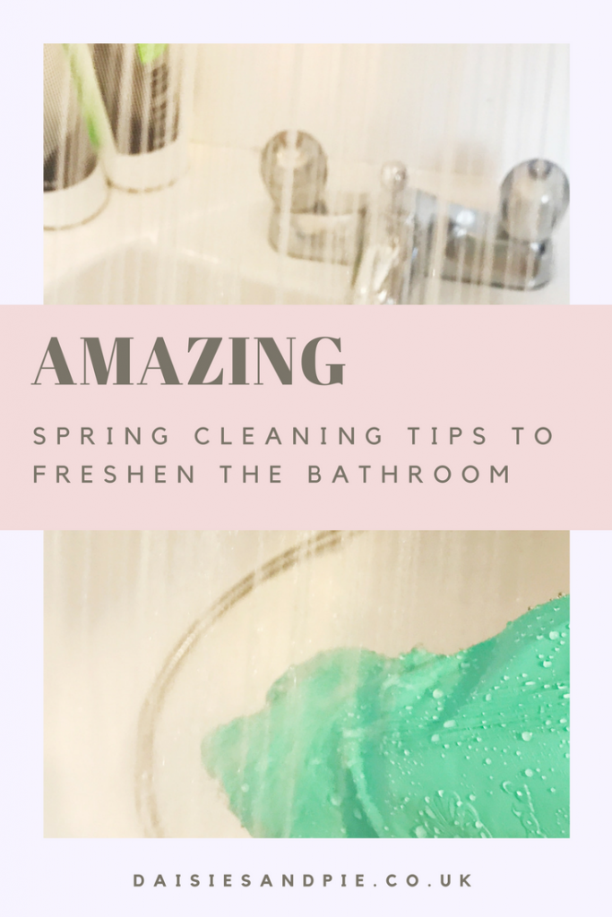 """white bath with silver taps and shower spraying into the bath, bottle of shampoo and conditioner on the side of the bath - hand in green Marigolds cleaning the bath. Text overlay saying """"Amazing spring cleaning tips to freshen the bathroom"""""""