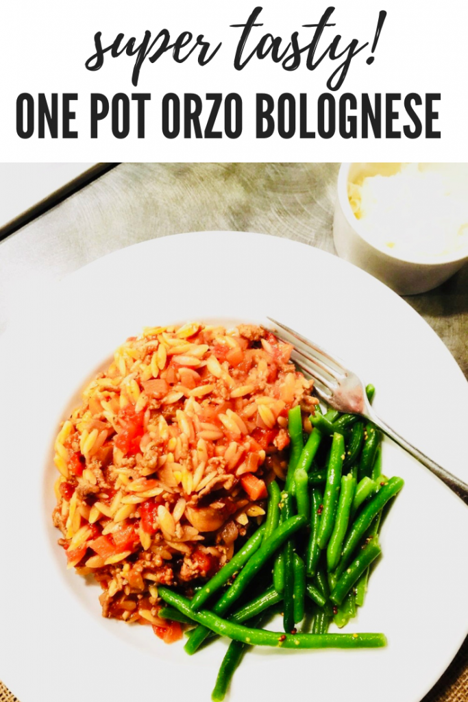 """one pot orzo beef bolognese served with green beans. Text overlay """"super tasty one pot orzo bolognese"""""""