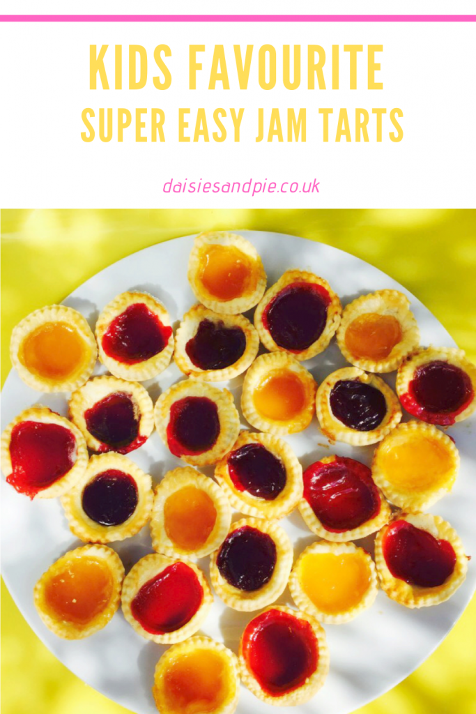 "large white plate filled with homemade jam tarts with strawberry, raspberry and apricot jam flavours. Text ""kids favourite - super easy jam tarts - www.daisiesandpie.co.uk"""