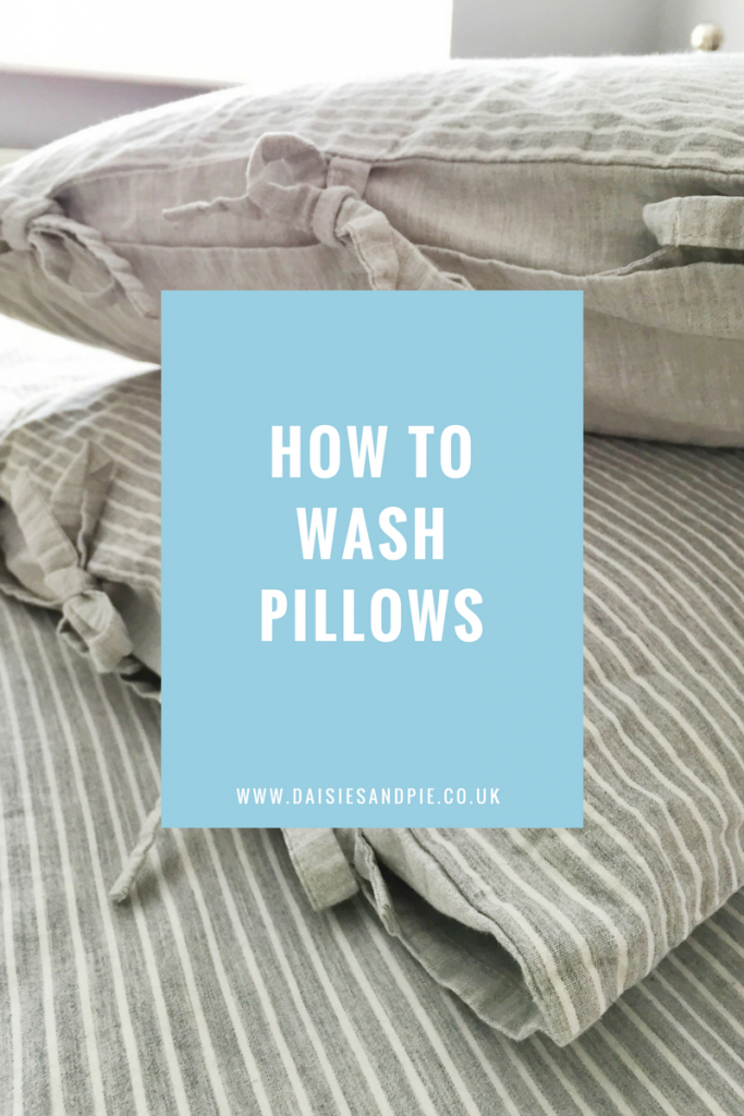 """small pile of grey and white striped pillows. Text overlay saying """"how to wash pillows"""""""