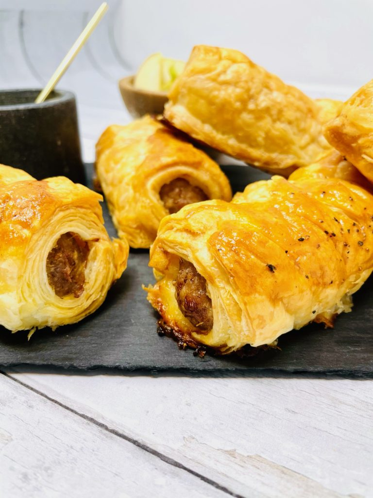 homemade sausage rolls served with a pot of mustard