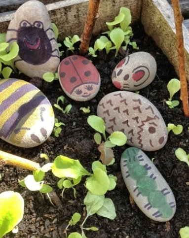 painted stone creatures, stone painting craft, stone crafts for kids, how to paint stone garden bugs, kids activities from daisies and pie