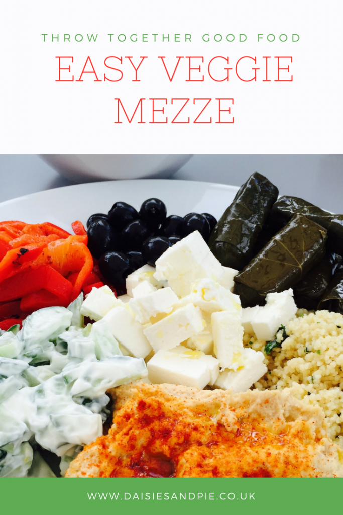 "mezze platter with homemade hummus, feta cheese, stuffed vine leaves, chargrilled peppers, vegetable couscous and black olives. Text overlay saying ""Throw together good food - easy veggie mezze"""