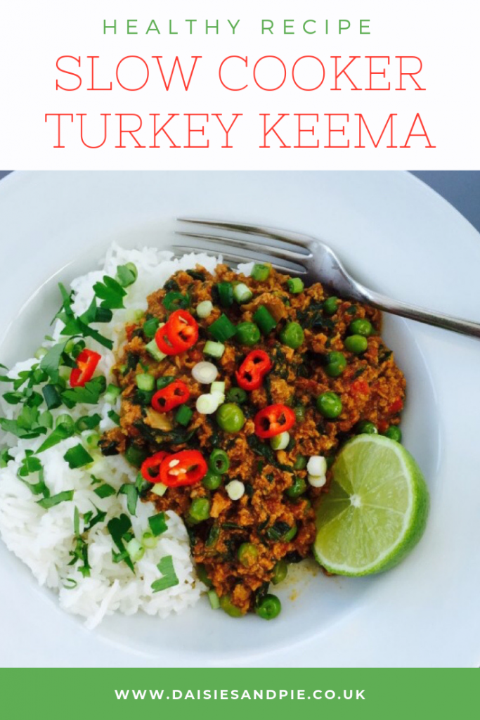 "Slow cooker turkey keema served with boiled rice and sprinkled with sliced chillies and spring onions. Text  ""healthy recipe - slow cooker turkey curry"""
