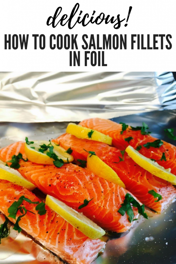 """salmon fillets in foil parcels with lemons and herbs. Text overlay """"delicious - how to cook salmon fillets in foil"""""""
