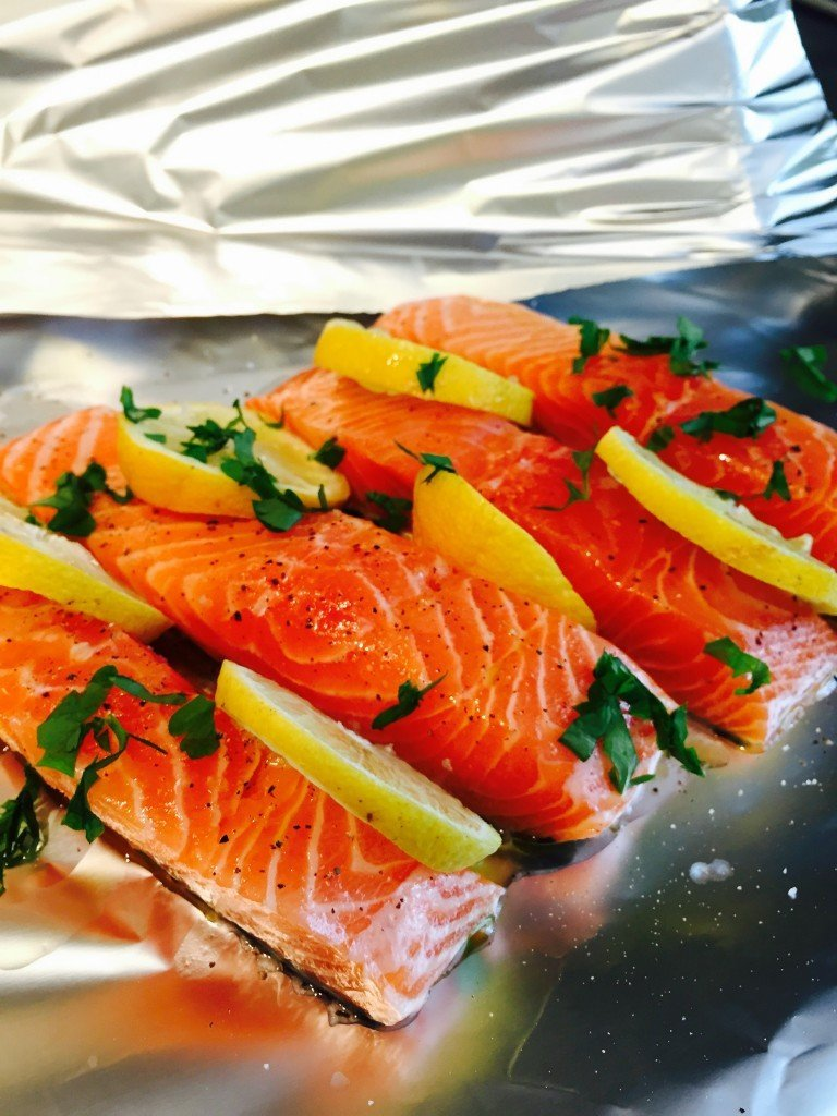 salmon fillets in foil parcel uk - with lemon slices and herbs